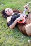 Asia women playing Ukulele Royalty Free Stock Photo