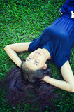 Asia women Relaxing in green grass Stock Photography