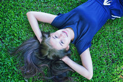 Asia women Relaxing in green grass Royalty Free Stock Photos