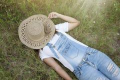 Asia women sleep on the green grass stock photo