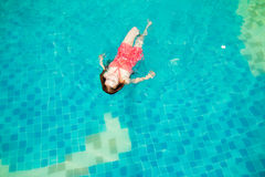 Asia Women swim in the pool. In the morning of summer Royalty Free Stock Images