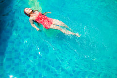 Asia Women swim in the pool. In the morning of summer Royalty Free Stock Image