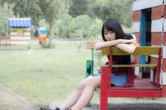 Asia women thai teen relax On Park Royalty Free Stock Photography