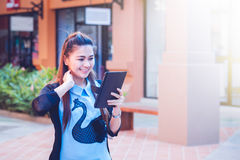 Asia women using tablet and cellphone in economic zones Royalty Free Stock Photo