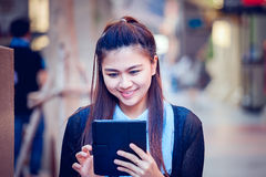 Asia women using tablet and cellphone in economic zones Stock Photography