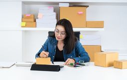 Asia women working business SME online at home. royalty free stock photos