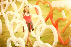 Asia young beautiful woman in heart park. Portrait of Asia young pretty girl in park royalty free stock photography