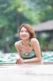 Asia young beautiful woman portrait in swimming pool Stock Photography