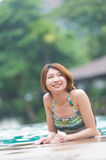 Asia young beautiful woman portrait in swimming pool Stock Images
