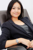 Asia young business woman. White background with the chair Stock Photo