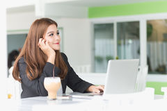 Asia young business woman in a cafe Stock Photography