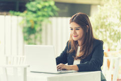 Asia young business woman in a cafe Royalty Free Stock Photo
