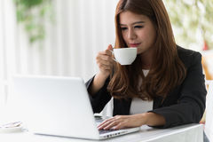 Asia young business woman in a cafe Stock Image