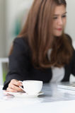 Asia young business woman in a cafe Stock Photos