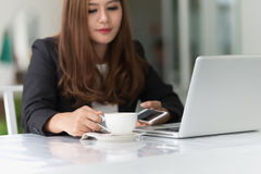 Asia young business woman in a cafe Royalty Free Stock Image