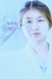 Asia young doctor woman with syringe in hospital Stock Image