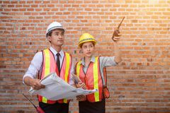 Asia, young engineers and women, quality inspection of building. Construction in buildings royalty free stock image