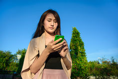 Asia young girl look into mobilephone Royalty Free Stock Photo