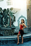 Asia young girl posing on background of city. Portrait of Asia young girl posing on background of city royalty free stock photo