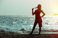 Asia young woman as silhouette by the sea. Portrait of asia young woman as silhouette by the sea stock photos