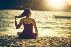 Asia young woman on beach near the sea royalty free stock image