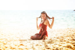 Asia young woman on beach near the sea. Portrait of Asia young pretty girl in park royalty free stock image