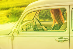 Asia Young woman driving vintage car Royalty Free Stock Image