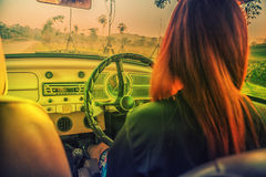 Asia Young woman driving vintage car Royalty Free Stock Photo