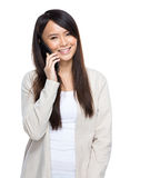 Asia young woman talking on mobile phone Royalty Free Stock Photography