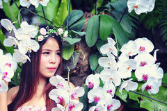 Asia young women with colorful flower in garden Stock Images