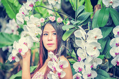 Asia young women with colorful flower in garden Stock Image