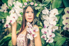Asia young women with colorful flower in garden Royalty Free Stock Images