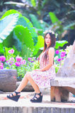 Asia young women sitting in colorful flower garden Stock Images