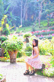Asia young women sitting in colorful flower garden Royalty Free Stock Image