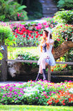 Asia young women sitting in colorful flower garden Royalty Free Stock Photos