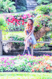 Asia young women sitting in colorful flower garden Stock Photography