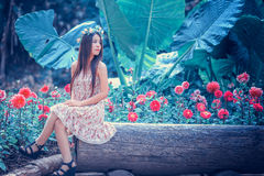 Asia young women sitting in colorful flower garden Stock Photo