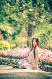 Asia young women sitting in colorful flower garden Royalty Free Stock Photography