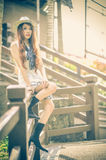 Asia young women sitting on wood terrace Royalty Free Stock Images