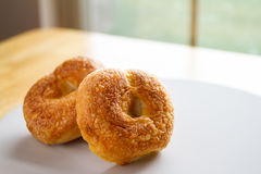 Asiago & Cheddar Cheese Bakery Fresh Bagel Stock Images