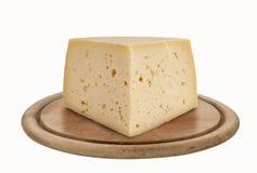 Asiago, formaggio italiano sul piatto di legno fotografia stock