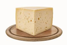 Asiago, Italian cheese on wooden plate royalty free stock images