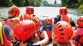 Group of tourists having fun doing water rafting point of view shot. Asiago, Italy - Ago 2018: Group of tourists having fun doing water rafting point of view stock footage