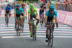 Asiago, Italy May 27, 2017: A Group of professional cycling with Davide Formolo passes the finish line after a hard mountain stage Stock Image