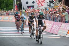 Asiago, Italy May 27, 2017: A Group of professional cycling passes the finish line after a tough mountain stage. Of the Giro D`Italia 2017 that arrive in Asiago Stock Photography