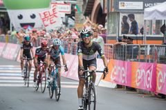 Asiago, Italy May 27, 2017: A Group of professional cycling passes the finish line after a tough mountain stage. Of the Giro D`Italia 2017 that arrive in Asiago Stock Photo