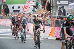 Asiago, Italy May 27, 2017: A Group of professional cycling passes the finish line after a tough mountain stage. Of the Giro D`Italia 2017 that arrive in Asiago Stock Images