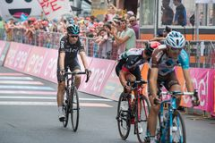 Asiago, Italy May 27, 2017: A Group of professional cycling passes the finish line after a tough mountain stage. Of the Giro D`Italia 2017 that arrive in Asiago Royalty Free Stock Photo