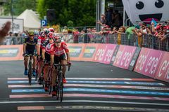 Asiago, Italy May 27, 2017: A Group of professional cycling passes the finish line after a tough mountain stage. Of the Giro D`Italia 2017 that arrive in Asiago Stock Photos