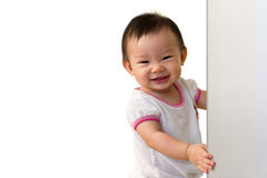Asian 10 month old baby girl, with cheeky smile. Isolated background perfect for text Stock Image